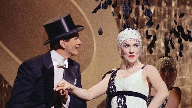 """FILE - In this May 10, 1967 file photo, actress Julie Andrews, right, is shown doing her first dance sequence, with singer-dancer Garrett Lewis, for the film, """"Star."""" A longtime friend of Garrett Lewis says he died Jan. 29, 2013 of natural causes.  He was 77. (AP Photo/David Smith, File)"""