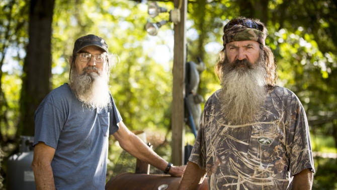 """This undated image released by A&E shows brothers Silas """"Uncle Si"""" Robertson, left, and Phil Robertson from the popular series """"Duck Dynasty."""" Phil Robertson was suspended for disparaging comments he made to GQ magazine about gay people but was reinstated by the network on Friday, Dec. 27. In a statement Friday, A&E said it decided to bring Robertson back to the reality series after discussions with the Robertson family and """"numerous advocacy groups."""" (AP Photo/A&E, Zach Dilgard)"""