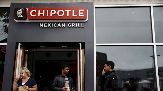 File photo of people carrying bags as they leave a Chipotle Mexican Grill restaurant in San Francisco, California