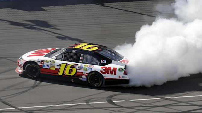 Greg Biffle celebrates his victory with a burnout after the NASCAR Sprint Cup Pure Michigan 400 auto race at Michigan International Speedway, Sunday, Aug. 19, 2012, in Brooklyn, Mich. (AP Photo/Paul Sancya)