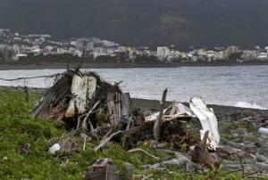 Debris that has washed onto the Jamaique beach in Saint-Denis is seen on the shoreline of the French Indian Ocean island of La Reunion