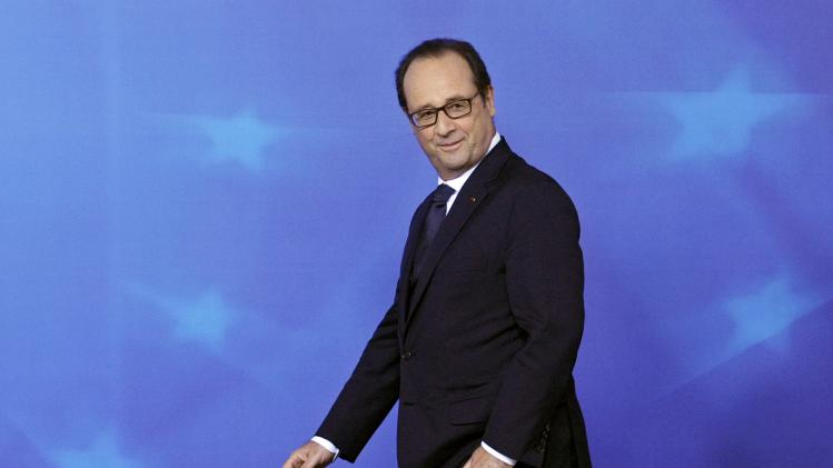 France's President Francois Hollande heads to a news conference after a EU summit in Brussels