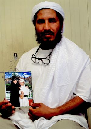 In this undated photo released by the family of Ahmed al-Darbi on Friday, Aug. 7, 2009, which was provided to them by the International Committee of the Red Cross, Guantanamo detainee Ahmed al-Darbi is seen at Camp 4 of the detention center on Guantanamo Bay Naval Base in Cuba. A Guantanamo Bay prisoner pleaded guilty Thursday to war crimes charges for helping plan the suicide bombing of an oil tanker off Yemen in 2002 that killed a crewman and wounded a dozen others. At an arraignment before a U.S. military judge, Ahmed al-Darbi of Saudi Arabia pleaded guilty to the five charges against him including terrorism, attacking civilians and hazarding a vessel for complicity in the al-Qaida attack on the French-flagged MV Limburg. (AP Photo)