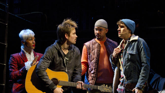 """In this theater publicity image released by Richard Kornberg & Associates, the cast of the Broadway production of """"Rent,"""" from left, MJ Rodriguez, Matt Shingledecker, Nicholas Christopher and Adam Chanler-Beratare are shown during a performance in New York. (AP Photo/Richard Kornberg & Associates, Joan Marcus)"""