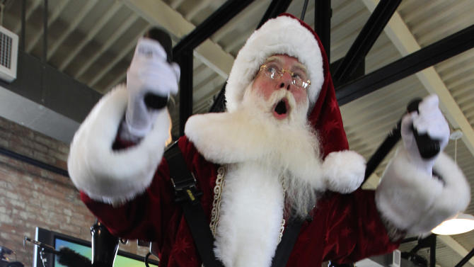 Donning a jetpack, Brady White portrays Santa Clause as he demonstrates gifts during the unveiling of the Neiman Marcus 2012 Christmas Book in Dallas, Tuesday, Oct. 9, 2012.  The Jetlev R200 is priced at $99,500. (AP Photo/LM Otero)