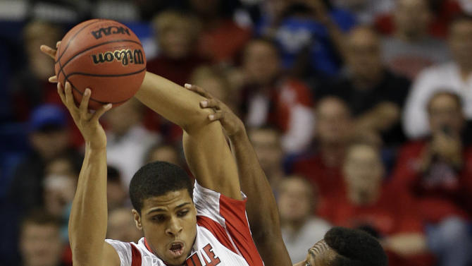 Louisville guard/forward Wayne Blackshear (20) pulls down a rebound in front of North Carolina A&T forward Bruce Beckford (34) during the first half  their second-round NCAA college basketball tournament game on Thursday, March 21, 2013, in Lexington, Ky. (AP Photo/John Bazemore)