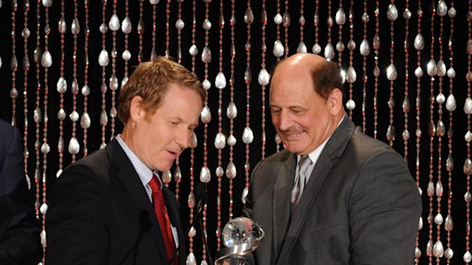 "Executive Producer Brent Shields (left) accepts the Academy Honor award for ""A Smile as Big as The Moon"" from presenter, football coach and special education teacher Mike Kersjes onstage at the Academy of Television Arts & Sciences Presents ""The 6th Annual Television Honors"" at the Beverly Hills Hotel on Thursday, May 9, 2013 in Beverly Hills, California. (Photo by Frank Micelotta/Invision for Academy of Television Arts & Sciences/AP Images)"