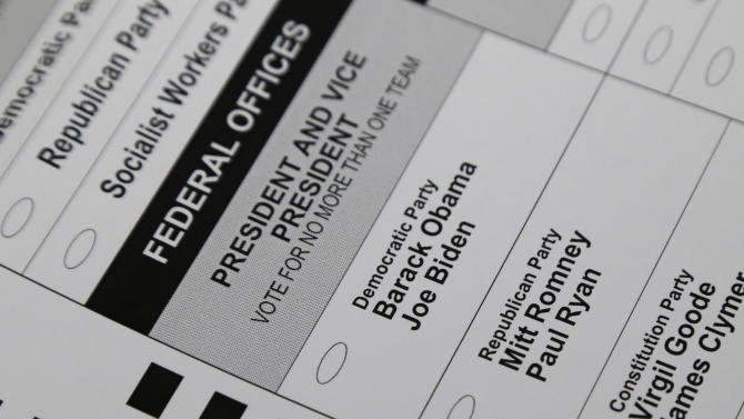 Presidential and vice presidential candidate names are seen on a ballot at the Polk County Election Office, Wednesday, Sept. 26, 2012, in Des Moines, Iowa. Voting in Iowa, one of 32 states that allow early voting, begins Thursday morning. (AP Photo/Charlie Neibergall)