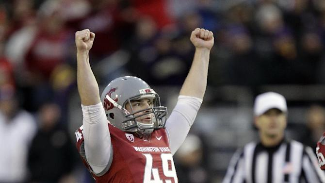 Washington State's Andrew Furney (49) celebrates after kicking a field goa against Washington in the fourth quarter of an NCAA college football game on Friday, Nov. 23, 2012, in Pullman, Wash. Furney went on to kick the game-winning field goal in overtime to give WSU a 31-28 win over Washington. (AP Photo/Ted S. Warren)