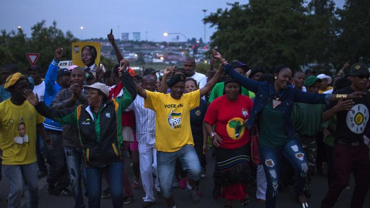 Supporters praise Nelson Mandela through dance and song while rallying through the streets of the Soweto area of Johannesburg