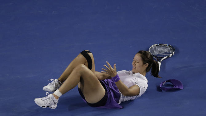 China's Li Na falls for a second time during her match against Victoria Azarenka of Belarus in the women's final at the Australian Open tennis championship in Melbourne, Australia, Saturday, Jan. 26, 2013. (AP Photo/Rob Griffith)