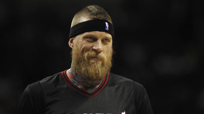Miami Heat forward Chris Andersen smiles at a fan during the second half of an NBA basketball game against the San Antonio Spurs on Thursday, March 6, 2014, in San Antonio. San Antonio won 111-87