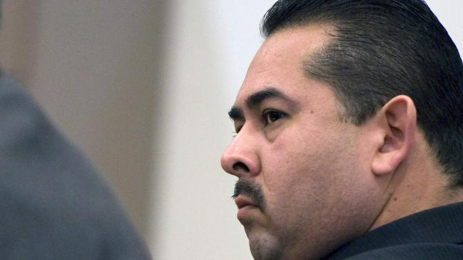 Former Fullerton police officer Manuel Ramos listens to closing arguments at his trial in Santa Ana