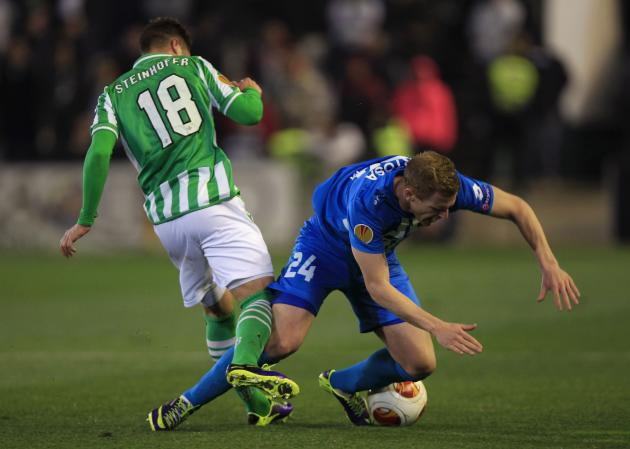 Real Betis' Steinhofer and Rijeka's Bertosa battle for the ball during their Europa League soccer match in Seville
