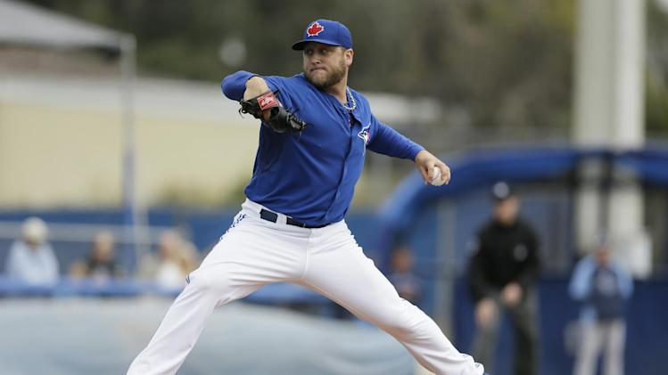 Toronto Blue Jays starting pitcher Mark Buehrle throws a pitch during the first inning of an exhibition baseball game against the Tampa Bay Rays Friday, March 7, 2014, in Dunedin, Fla. (AP Photo/Charlie Neibergall)