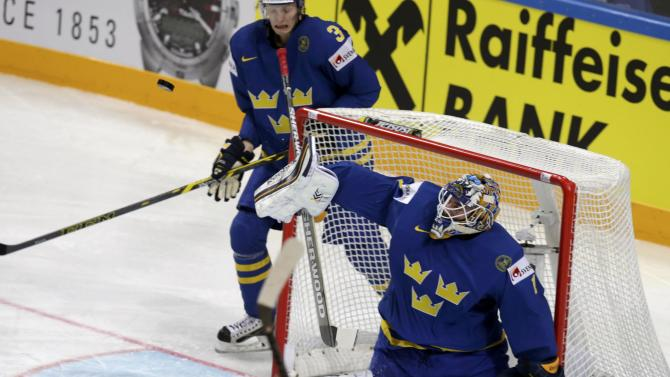 Sweden's goaltender Enroth saves a shot during their Ice Hockey World Championship game against Latvia at the O2 arena in Prague