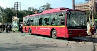 Indian police stand beside a bus with shattered windows after youths hurled stones at buses and police outside a hospital in a low-income area of New Delhi on March 1, 2013. Hundreds of protesters clashed with police on Friday outside a New Delhi hospital where a seven-year-old girl who was sexually assaulted at school was admitted earlier in the day, police said