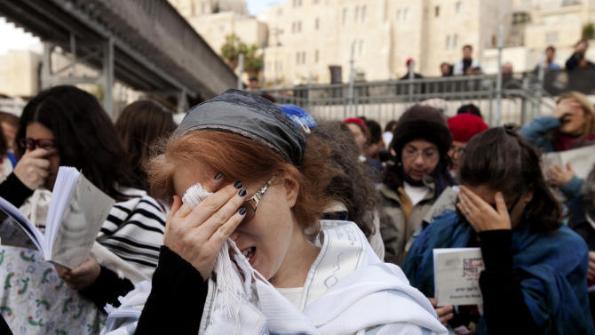 Israeli women pray at the Western Wall in  Jerusalem,  Thursday, April 11, 2013. Israeli police have detained five women while praying at the Western Wall in Jerusalem for performing religious rituals that ultra-Orthodox Jews say are reserved for men. Police spokesman said about 120 woman arrived for their monthly prayer service Thursday and five were detained for wearing prayer shawls. (AP Photo/Michal Fattal)
