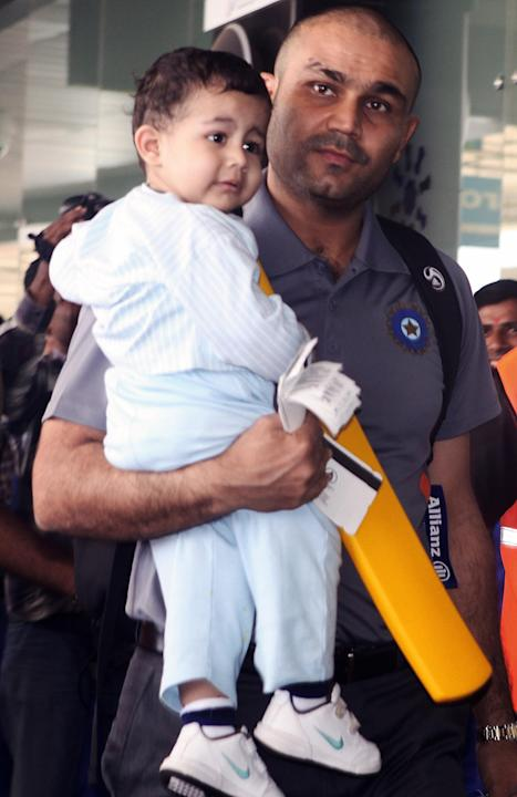 Indian cricketer Virender Sehwag carries