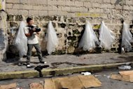 Philippine director Brillante Mendoza films in a street in Manila in 2009. The number of films produced in the Philippine movie industry has halved over the past decade in the face of piracy and Hollywood competition, a government study released Wednesday showed