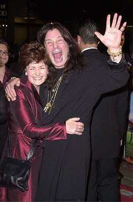 Premiere: The Ozzman High-Fiveth - Ozzy Osbourne and his wife at the Mann's Chinese Theatre premiere of New Line's Little Nicky - 11/2/2000
