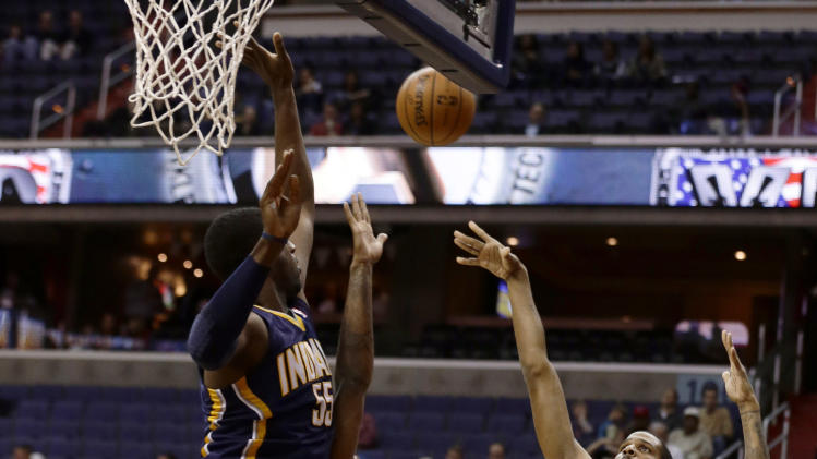 Washington Wizards forward Trevor Ariza shoots over Indiana Pacers center Roy Hibbert, left, and forward Paul George in the first half of an NBA basketball game Monday, Nov. 19, 2012, in Washington. (AP Photo/Alex Brandon)