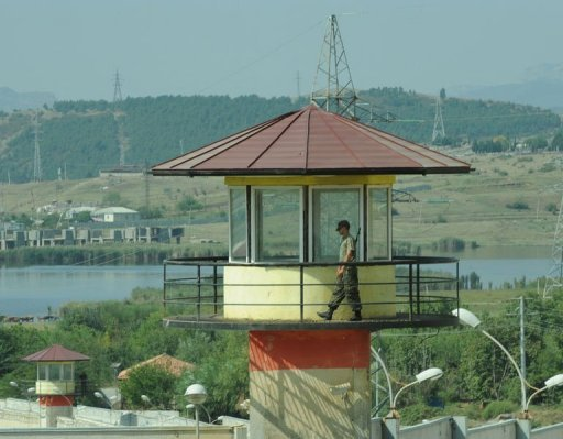 <p>A guard walks on a watchtower of the Gldani prison, the site of recent jail abuse scandal , in Tbilisi. A former Georgian jail guard who made videos of prisoners being raped and beaten that shocked the nation and sparked widespread protests said he acted to end torture in the ex-Soviet state.</p>