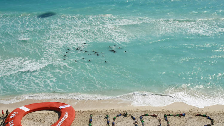 **  CORRECTS MONTH TO DECEMBER  **  Greenpeace activists form the word hope as a question with their bodies, next to a giant life saver, during a demonstration near the site of the United Nations Climate Change Conference in Cancun, Mexico, Friday, Dec. 10, 2010.  (AP Photo/Israel Leal)