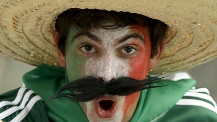 Mexico fans wait for the start of a group A World Cup soccer match between Croatia and Mexico at the Arena Pernambuco in Recife, Brazil, Monday, June 23, 2014. (AP Photo/Hassan Ammar)