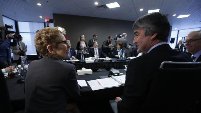 Ontario Premier Wynne talks with Nova Scotia Premier McNeil before the start of a meeting of provincial and territorial premiers in Ottawa