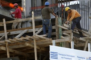 "Workers are seen on a building under construction behind a sing with a Greek flag which reads ""Greek Culture Ministry"" in Athens on Thursday, Nov. 8, 2012. Figures Thursday showed unemployment figures up at 25.4 percent in August, increasing from 24.8 percent in July and 18.4 percent the year before. More than 1.2 million people in this country of barely 10 million are now unemployed, with 58 percent of all young people aged 15-24 are unemployed. (AP Photo/Petros Giannakouris)"