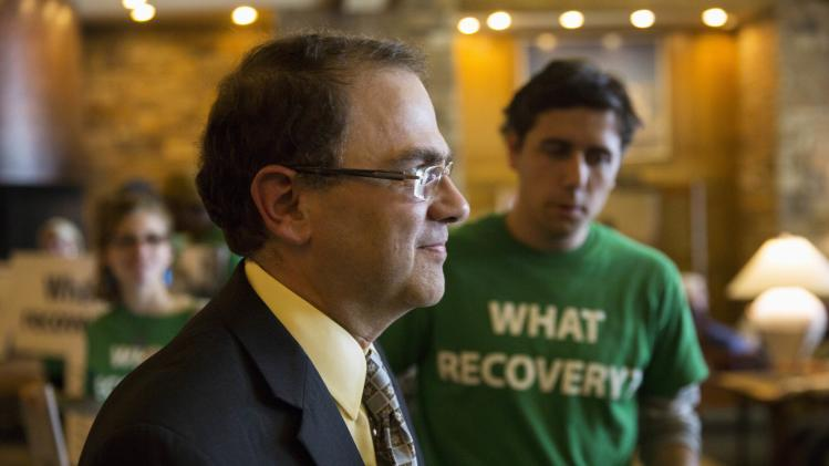 Narayana Kocherlakota, President and CEO of the Federal Reserve Bank of Minneapolis, arrives at the opening reception of the Jackson Hole Economic Policy Symposium in Jackson Hole