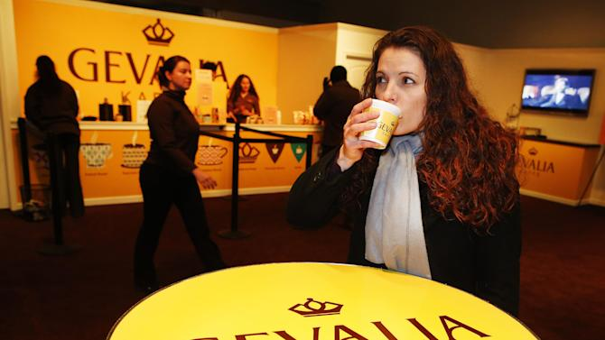 IMAGE DISTRIBUTED FOR GEVALIA - Marcia Cook, 38, from Pennsylvania, enjoys Gevalia coffee at a temporary store at 253 West 47th Street to treat New Yorkers and visitors to free cups of premium Gevalia coffee through Dec. 31, on Thursday, Dec. 27, 2012, in New York. (John Minchillo /AP Images for Gevalia)
