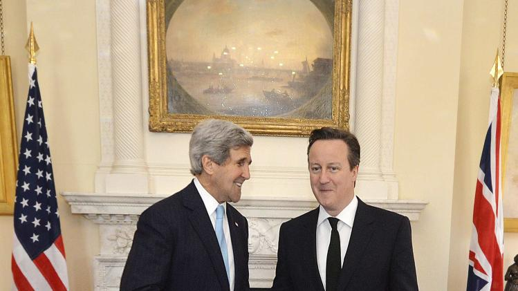 U.S. Secretary of State John Kerry shakes hands with British Prime Minister David Cameron upon arriving at Number 10 Downing Street in central London