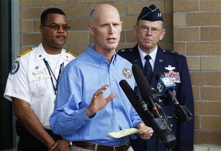 Florida Governor Rick Scott (C) speaks during a news conference as Tropical Storm Issac approaches the state amid final preparations for the Republican National Convention in Tampa, Florida August 26, 2012. REUTERS/Joe Skipper