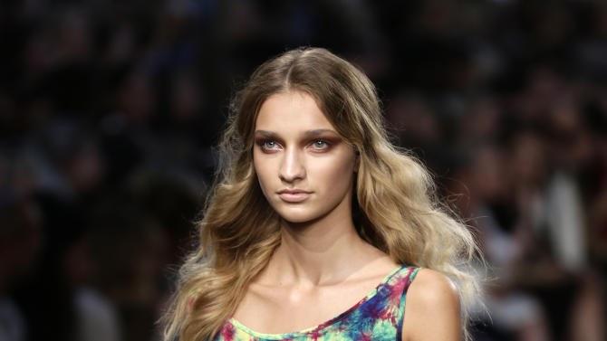A model wears a creation by House of Holland for their Spring/Summer 2013 presentation at London Fashion Week in London, Saturday, Sept. 15, 2012. (AP Photo/Alastair Grant)