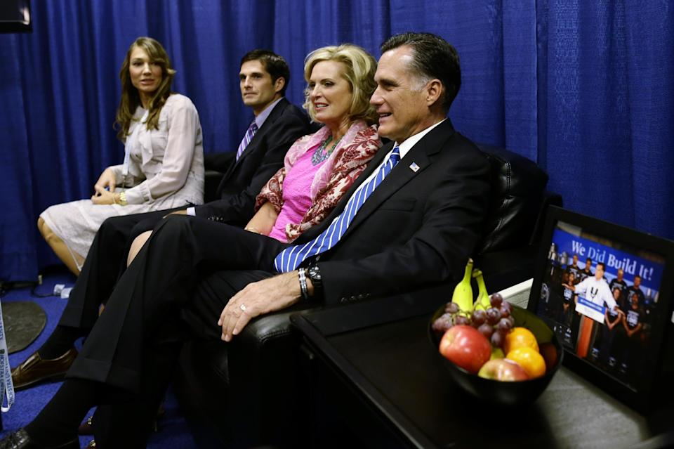 Republican presidential candidate and former Massachusetts Gov. Mitt Romney sits with wife Ann and son Matt and daughter-in-law Laurie in a holding room before he participates in the second presidential debate with President Barack Obama at Hofstra University in Hempstead, N.Y., Tuesday, Oct. 16, 2012. (AP Photo/Charles Dharapak)