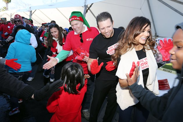 IMAGE DISTRIBUTED FOR MATTEL - From right, WWE stars Diva Eve and The Miz, Bryan Stockton, Mattel CEO, and Deidre Lind, Executive Director, Mattel Children's Foundation, greet Los Angeles school child
