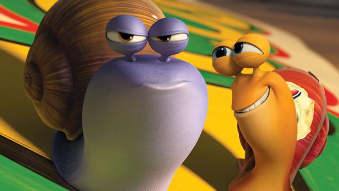 """This film publicity image released by DreamWorks Animation shows Chet, voiced by Paul Giamatti, left, and Turbo, voiced by Ryan Reynolds in a scene from the animated movie """"Turbo."""" (AP Photo/DreamWorks Animation)"""