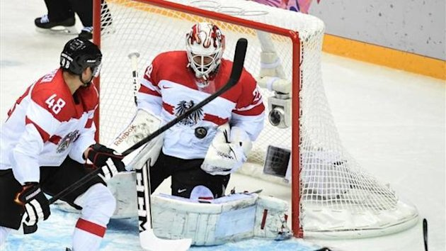 Austria's ice hockey goalie Bernhard Starkbaum makes a save