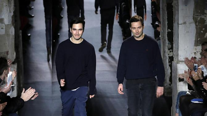 FILE - This Feb. 13, 2013 file photo shows designers Jack McCollough, right, and Lazaro Hernandez after the Proenza Schouler Fall 2013 collection is shown during Fashion Week in New York. Alexander Wang and Proenza Schouler are among the leading nominees for this year's Council of Fashion Designers of America awards. CFDA president Diane von Furstenberg and CEO Steven Kolb announced Wednesday evening that Proenza's Lazaro Hernandez and Jack McCollough, and Wang were in the running for both womenswear designer of the year as well as the accessories category.   (AP Photo/Seth Wenig, file)