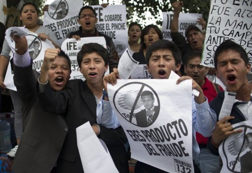 "<p>Demonstrators protest outside the Federal Electoral Institute in Mexico City, on July 5. Activists opposed to the victory of Enrique Pena Nieto in Mexico's presidential election have called for a national ""megamarch"" Saturday to protest the results</p>"