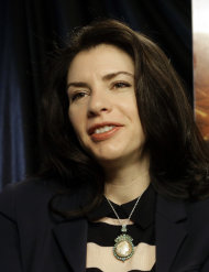 "This Feb. 19, 2013 photo shows author Stephenie Meyer in Miami. Meyer, author of the ""Twilight"" saga says she's working on a new series. She wrote ""The Host"" as an escape from editing of one of the books in the popular vampire series. The movie adaption of ""The Host"" premieres March 29. (AP Photo/Alan Diaz)"