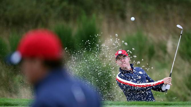 Jimmy Walker of the US plays out of the bunker onto the 9th green during a practice round ahead of the Ryder Cup golf tournament at Gleneagles, Scotland, Tuesday, Sept. 23, 2014. (AP Photo/Scott Heppell)