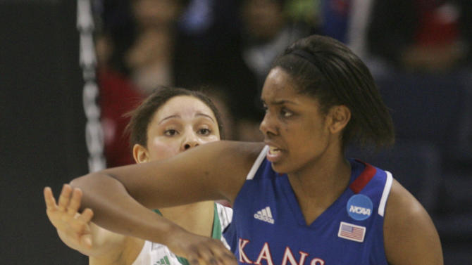 Kansas forward Chelsea Gardner (15) tries to fend off Notre Dame forward Natalie Achonwa (11) during the first half a regional semi-final of the NCAA college basketball tournament Sunday, March31, 2013, in Norfolk, Va.  (AP Photo/Jason Hirschfeld)