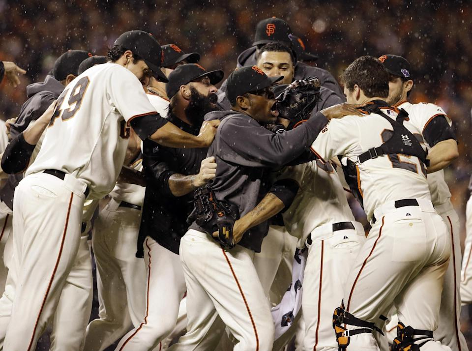 The San Francisco Giants celebrate after the final out in Game 7 of baseball's National League championship series against the St. Louis Cardinals Monday, Oct. 22, 2012, in San Francisco. The Giants won 9-0 to win the series. (AP Photo/David J. Phillip)
