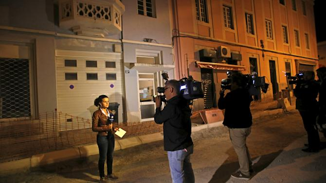Media members stand near the house where former Portuguese Prime Minister Jose Socrates is placed under house arrest in Lisbon, Portugal