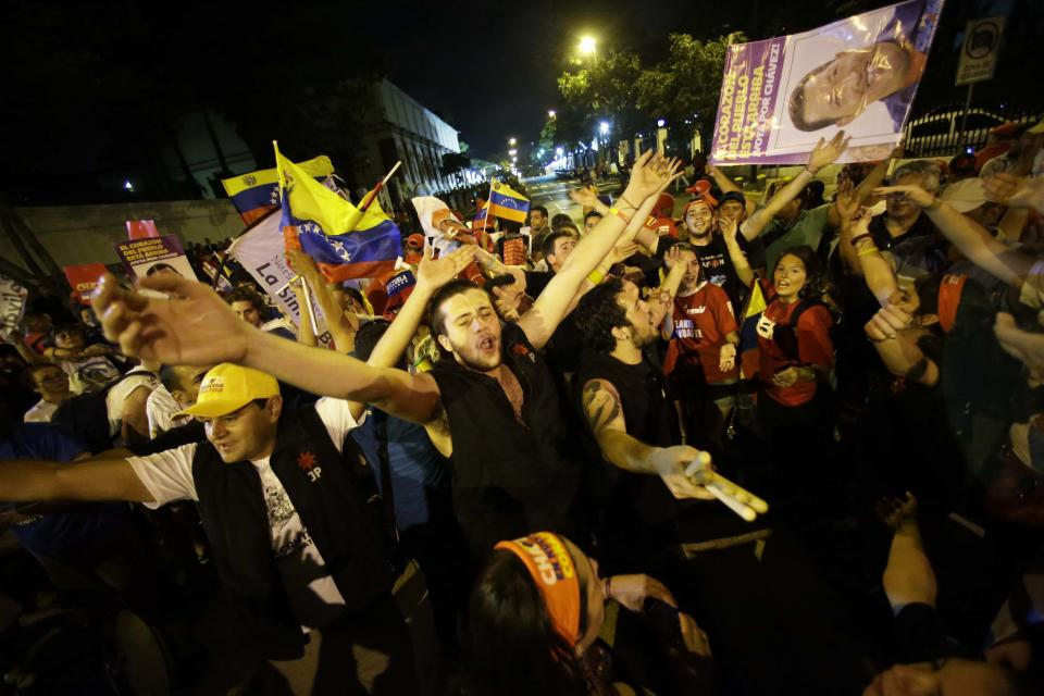 Supporters of Venezuela's President Hugo Chavez cheer after polling stations closed and before any results were made available outside Miraflores presidential place in Caracas, Venezuela, Sunday, Oct. 7, 2012. Chavez is running for re-election against opposition candidate Henrique Capriles. (AP Photo/ Fernando Llano)