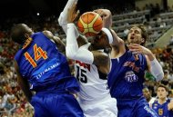 Carmelo Anthony of the US Men's Senior National Team, center, dives for the ball against Serge Ibaka of the Spain Men's Senior National Team, left, and Pau Gasol during an exhibition match between Spain and the United States Tuesday, July 24, 2012, in Barcelona, Spain, in preparation for the 2012 Summer Olympics. (AP Photo/Manu Fernandez)