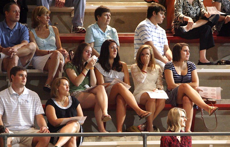 Students mourn during a memorial service for the six University of Alabama students who were killed during the April 27 tornado that ripped through Tuscaloosa hosted in Foster Auditorium Friday, Aug. 5, 2011. (AP Photo/Michelle Lepianka Carter - Tuscaloosa News)